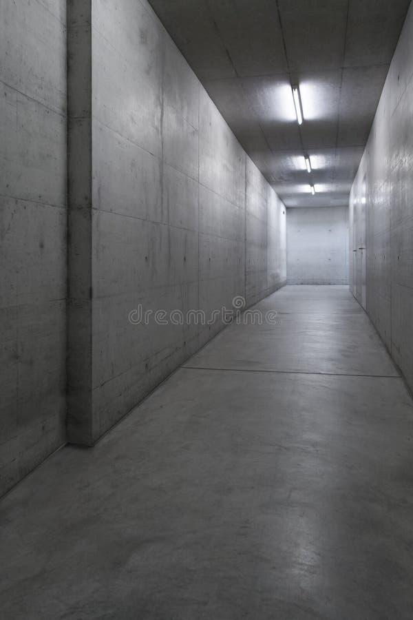 Concrete corridor in the building stock image