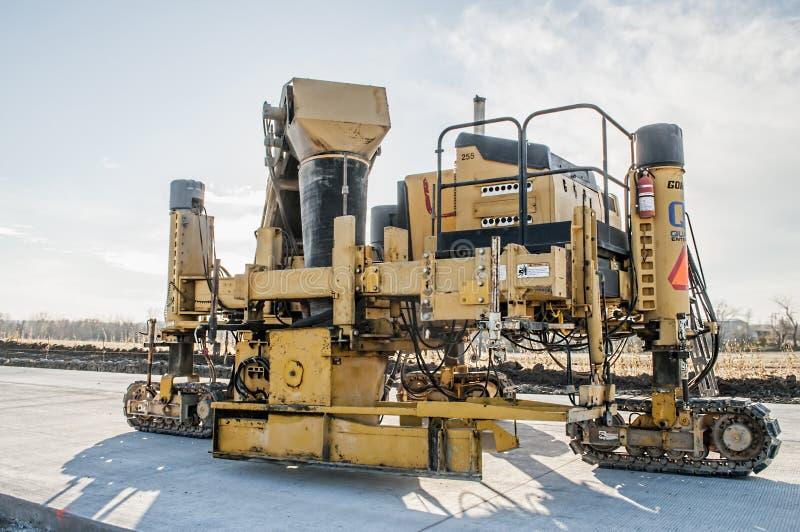 Concrete Crawler highway Curb Machine royalty free stock photo