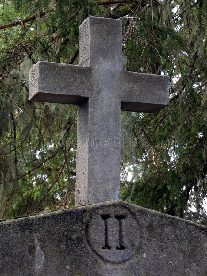 Concrete Cross. Simple cross situated in a peaceful wooded environment stock images