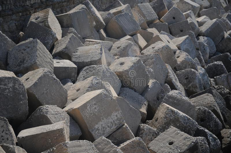 Concrete cube forms interlocked to make a sea wall breakwater stock photography