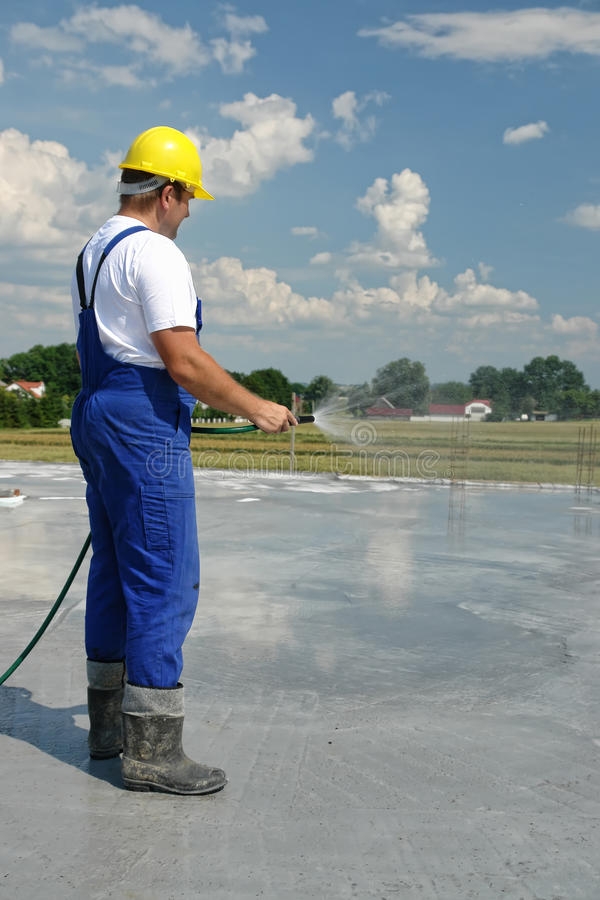 Builder Worker Vibrating Concrete In Form Stock Photo