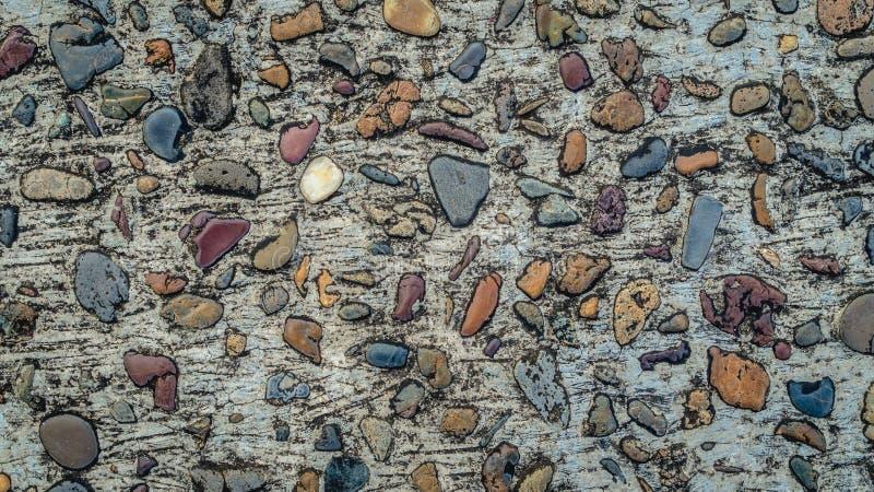 Concrete de textuur kleurrijke achtergrond van grintstenen royalty-vrije stock foto's