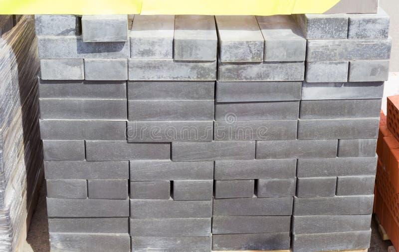 Concrete decorative bricks gray color on a warehouse. Pallet of the concrete decorative bricks gray color on a warehouse outdoor stock images