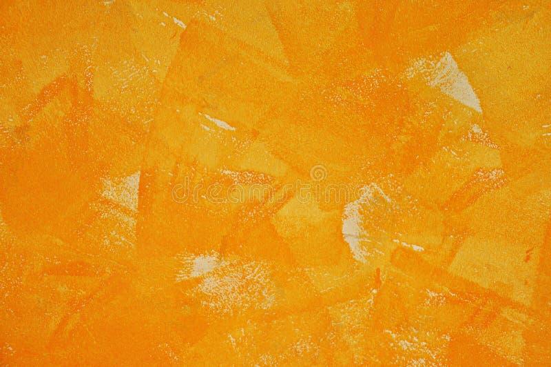 Concrete die muur met oranje kleur wordt gestempeld stock fotografie