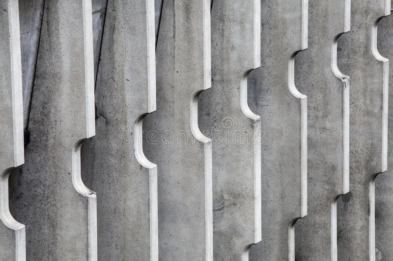 Concrete dividers. Vertical stripes modern building royalty free stock photos