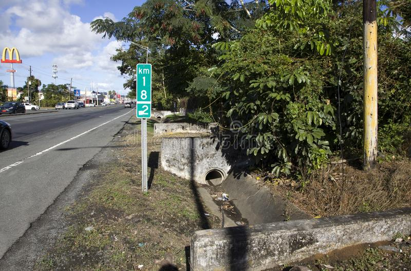 Concrete drainage channel in Bayamon Puerto Rico. BAYAMON, PUERTO RICO/USA - February 9, 2019: Outdoor street concrete drainage channel stock images