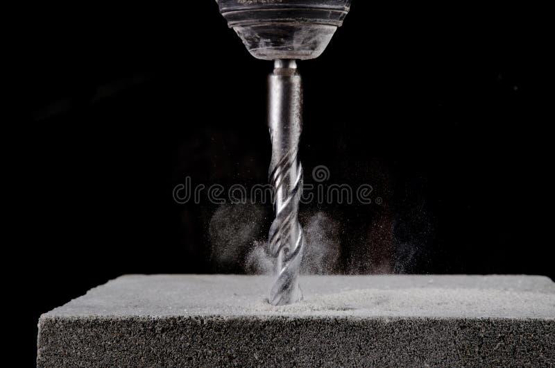 Concrete drill bit. Closeup view of rotating concrete drill bit royalty free stock photos