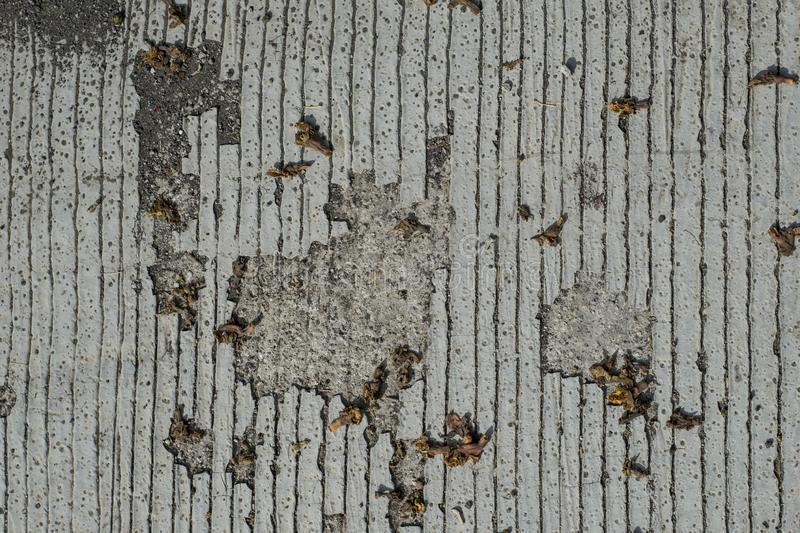 Concrete floor with lines and weather caused holes.  royalty free stock photos