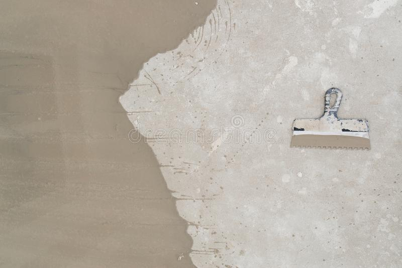Concrete floor and scraper. Top view copy space royalty free stock photos