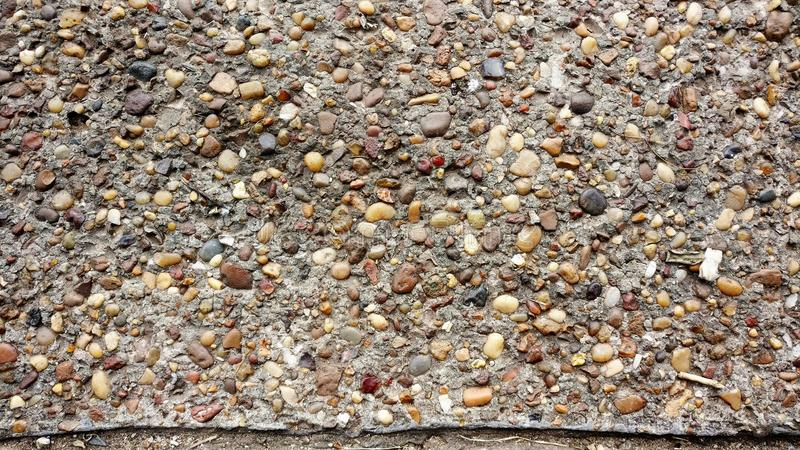 Concrete floor with stones. Concrete floor with different color stones stock photos
