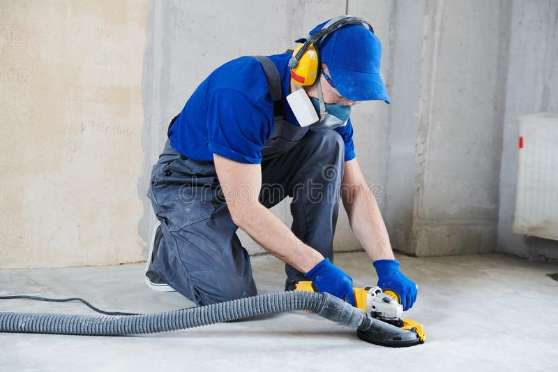 Concrete floor surface grinding by angle grinder machine royalty free stock image