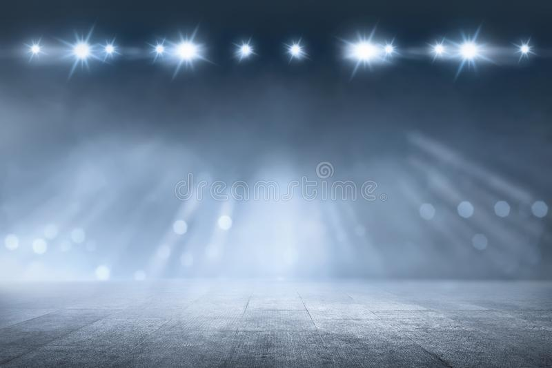 Concrete floor with white lamp spotlight royalty free stock images