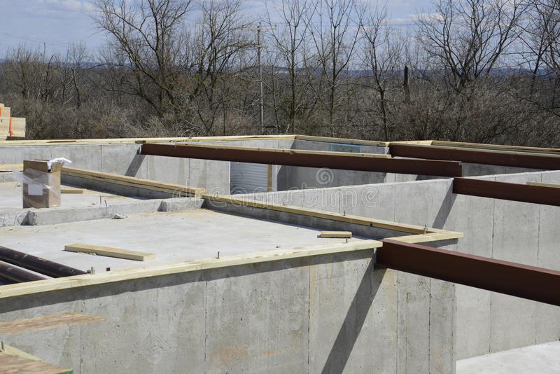 Concrete foundation with steel beams for the floor joist. Concrete foundation with steel beams which will become the floor joist royalty free stock images