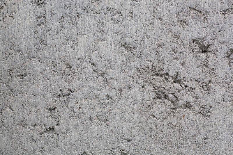Concrete frozen on the wall of a new building with for What happens to concrete if it freezes