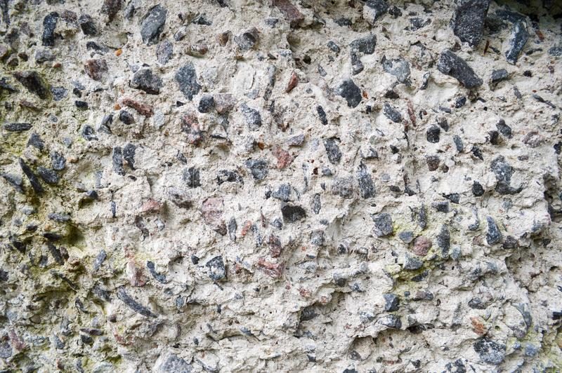 Concrete gray old stone sharp texture with shards of various stones of different shapes. Background royalty free stock image