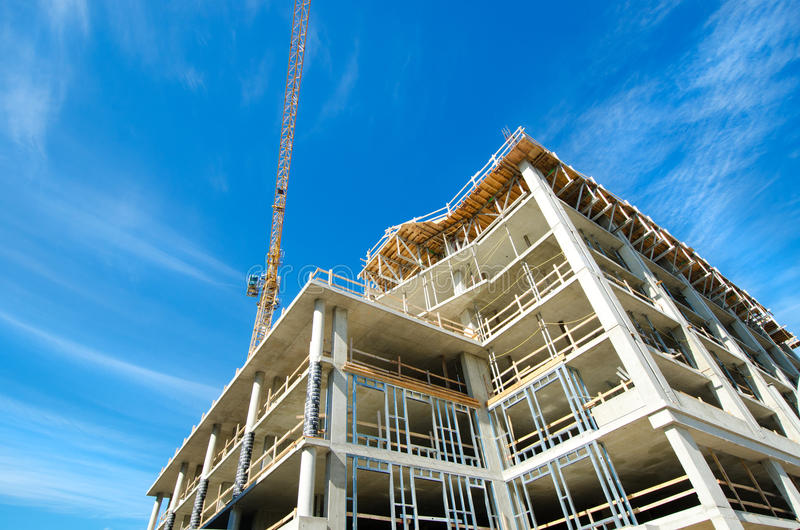 Concrete Highrise bouwwerf, met Torenkraan stock fotografie
