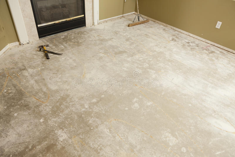 Concrete House Floor with Broom Ready for Flooring Installation stock photography