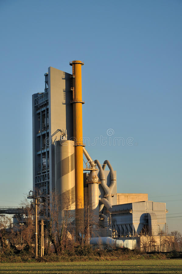 Concrete industrial plant, lombardy. Foreshortening of cement industrial plant, shot in in winter windy and sunny weather in plains of lombardy royalty free stock images