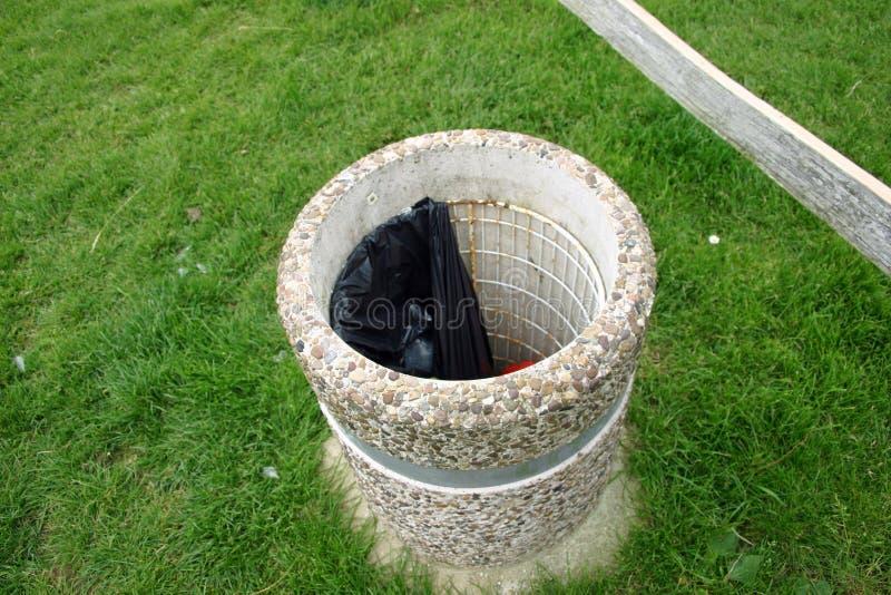 Concrete litter bin royalty free stock photo