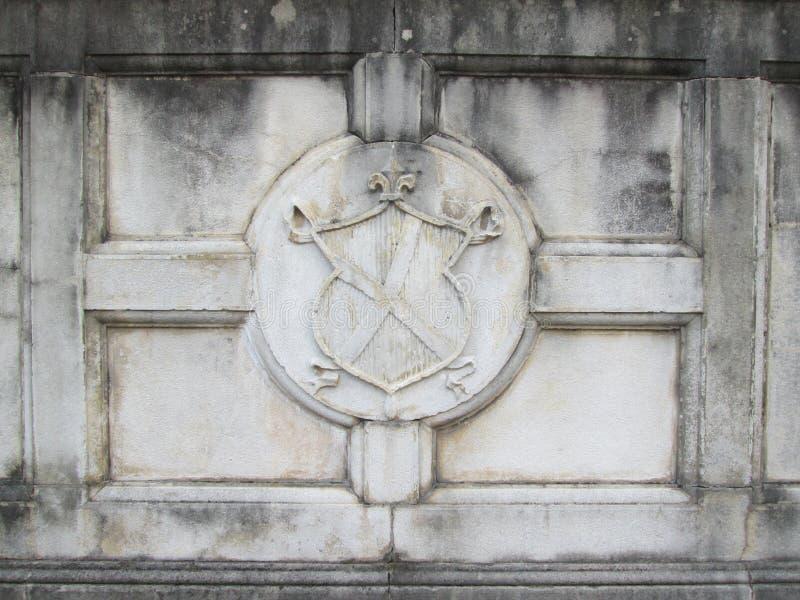 Concrete medieval emblem. Gray concrete medieval emblem for background textures royalty free stock photo