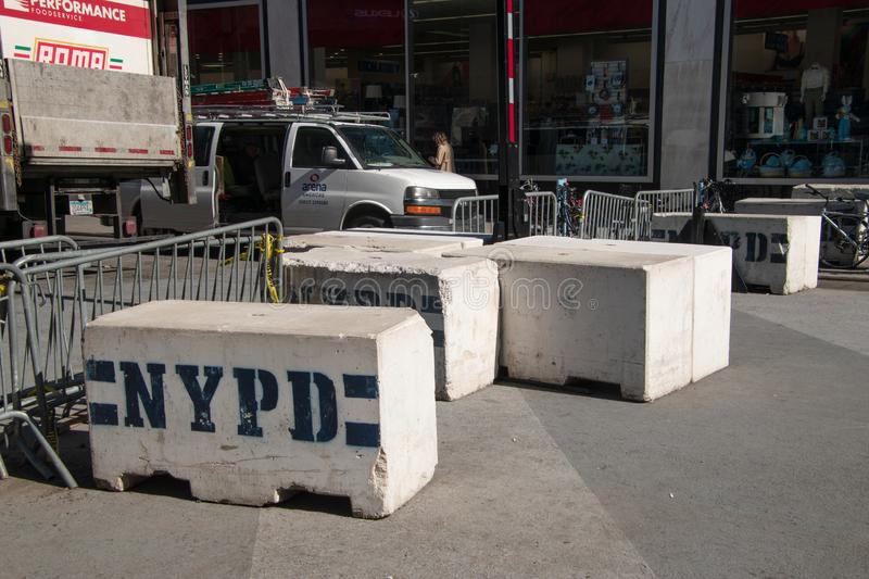 Concrete and metal NYPD street barricades on a Manhattan New York street near a police station royalty free stock photo
