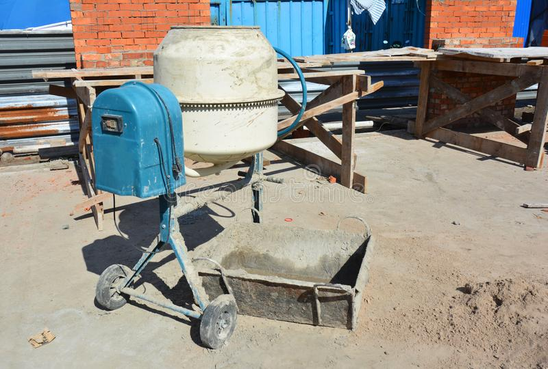 Concrete mixer, Concrete blender is a device that homogeneously combines cement, aggregate such as sand or gravel, and water to fo. Concrete blender is a device royalty free stock photos