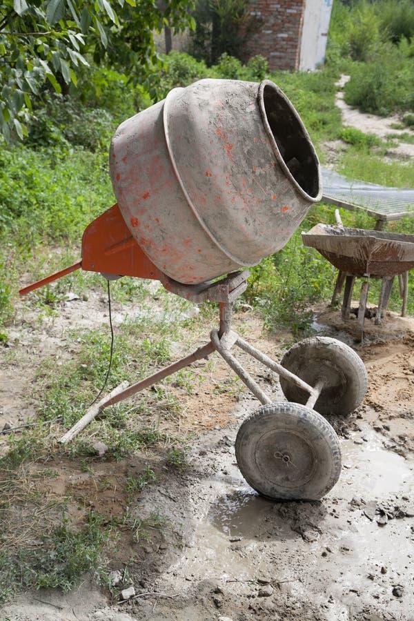 Concrete mixer. Cement mixer on courtyard with selective focus stock photography