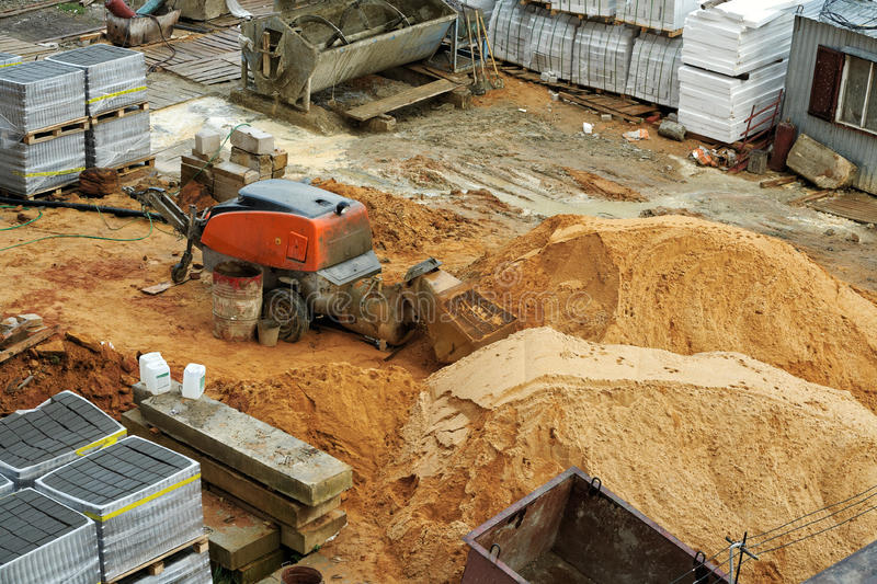 Concrete mixer. Sand and cement mixer at a construction site stock photography
