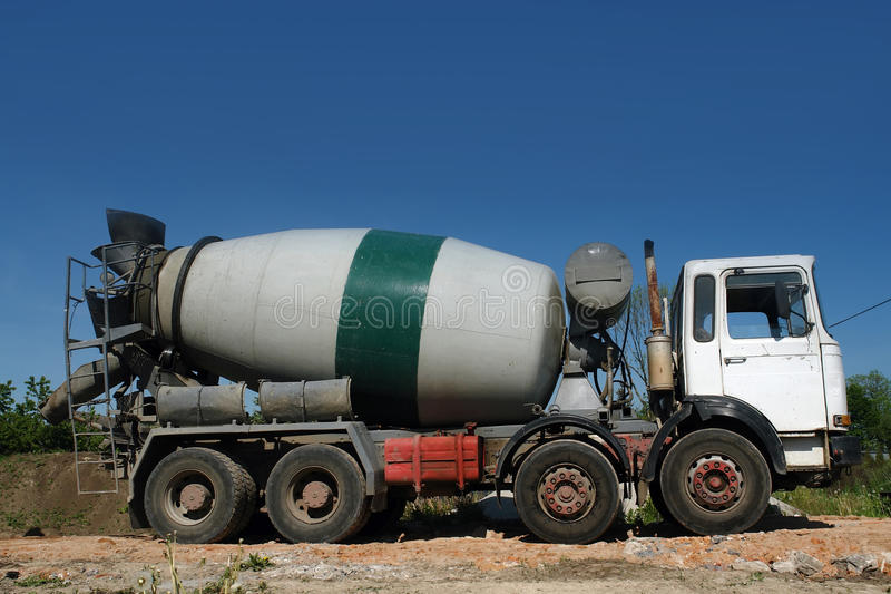 Concrete mixer truck. Parked at construction site stock photo