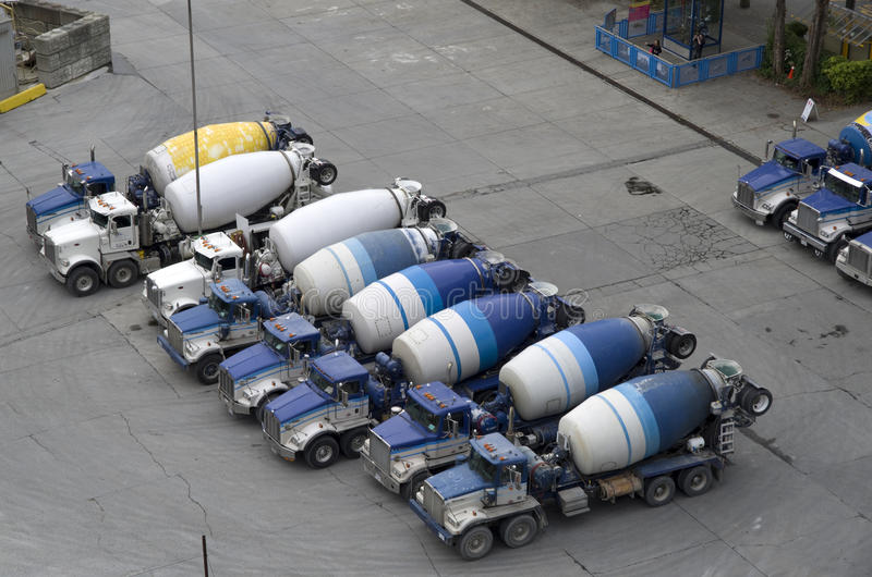 Concrete mixer truck factory. Concrete mixers lined up in a factory in Vancouver, Canada stock photos