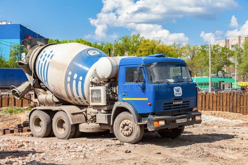 Concrete mixer truck KAMAZ at the construction of road. SAMARA, RUSSIA - MAY 7, 2016: Concrete mixer truck KAMAZ at the construction of road royalty free stock photography