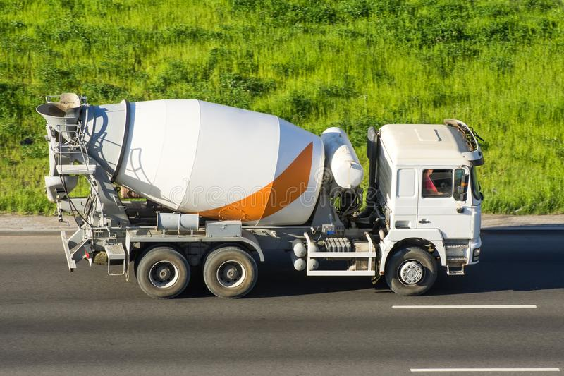 Concrete Mixer Truck rides the road highway. Concrete Mixer Truck rides the road highway royalty free stock photo