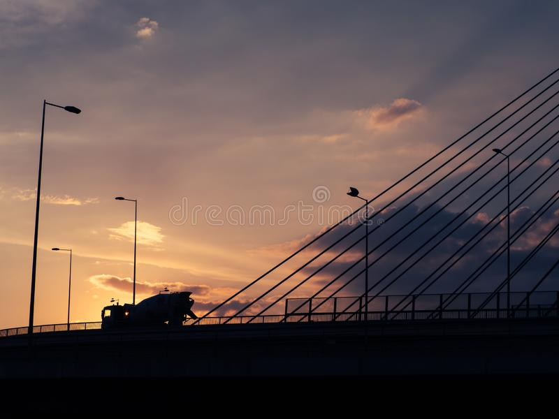Concrete mixer truck at sunset royalty free stock photography