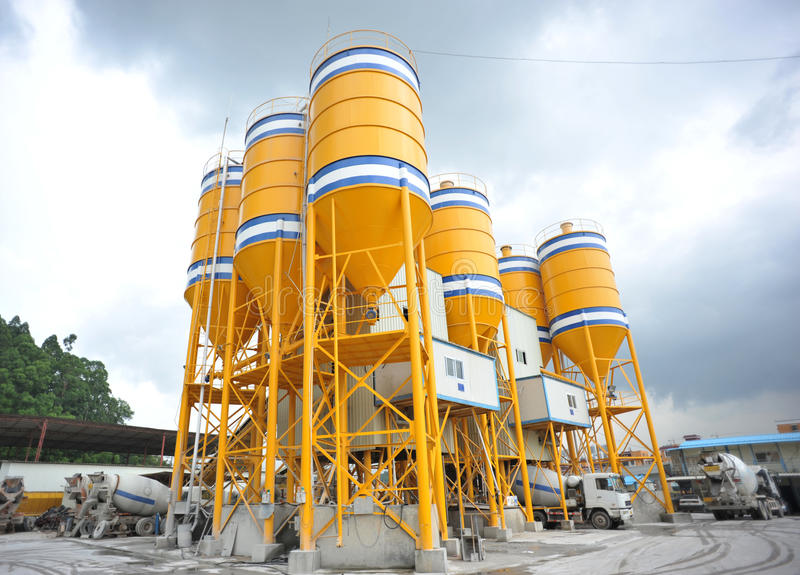 Concrete mixing plants. Large yellow concrete mixing plants background sky royalty free stock photo