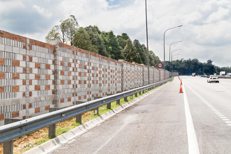 Concrete noise barrier wall along busy noisy highway stock