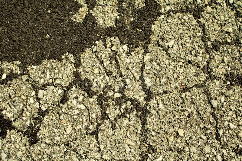 Concrete on an old road in upstate New York. New and old concrete texture on the road i was driving on royalty free stock image
