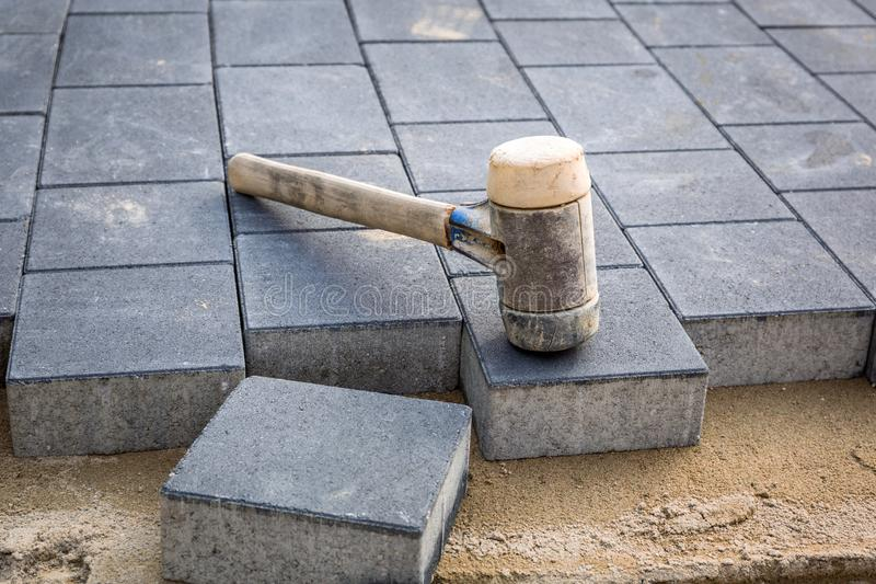 Concrete paver blocks laid with rubber hammer royalty free stock image
