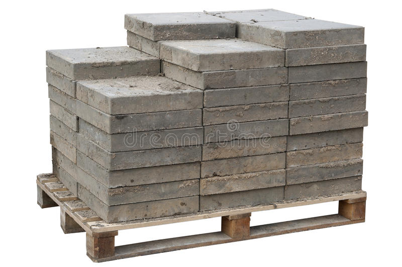 Concrete paving blocks are accurately put on wooden pallet. The old concrete paving blocks are accurately put on wooden pallet. Isolated. After repair of the royalty free stock photos