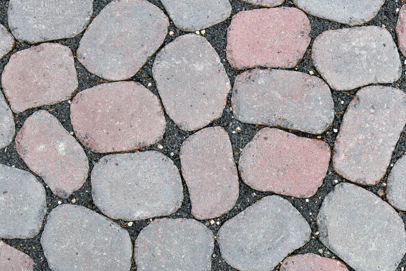 Concrete paving stones. Irregularly laying concrete paving stones royalty free stock photo