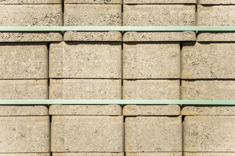 Concrete paving stones on wooden pallets at a road construction site in town. In germany stock photos