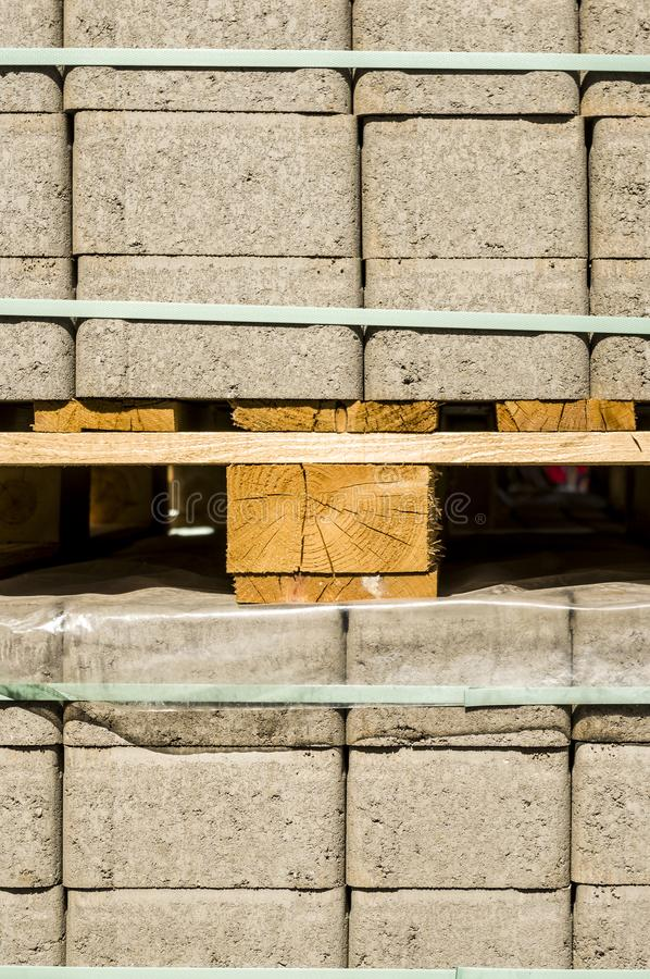 Concrete paving stones on wooden pallets at a road construction site in town. In germany royalty free stock images