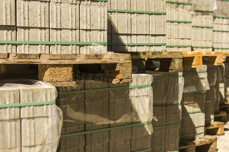 Concrete paving stones on wooden pallets at a road construction site in town. In germany stock images