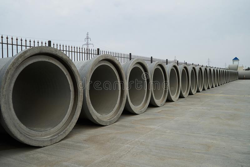 Concrete pipe factory warehouse. Industry manufacturing concept royalty free stock photo