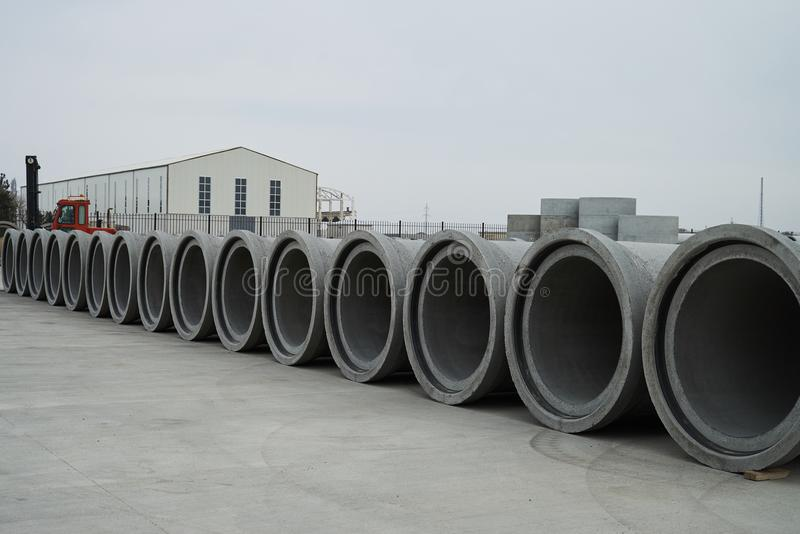 Concrete pipe factory warehouse. Industry manufacturing concept royalty free stock photography