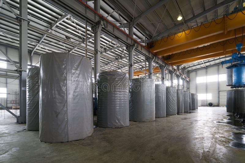 Concrete pipe factory warehouse. Industry manufacturing concept stock photos