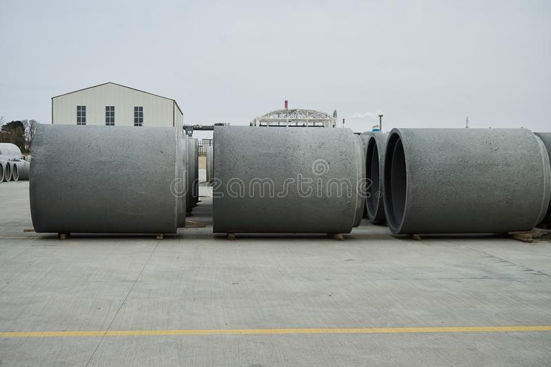Concrete pipe factory warehouse. Industry manufacturing concept stock image