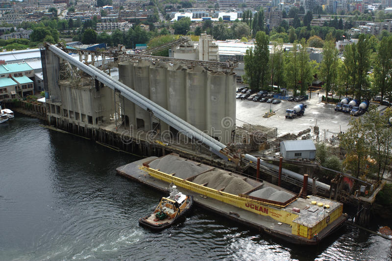 Concrete Plant, Ocean Construction Supplies Ltd. Looking onto the Ocean Construction Supplies Ltd. concrete plant as a barge is docked at its Granville Island royalty free stock image
