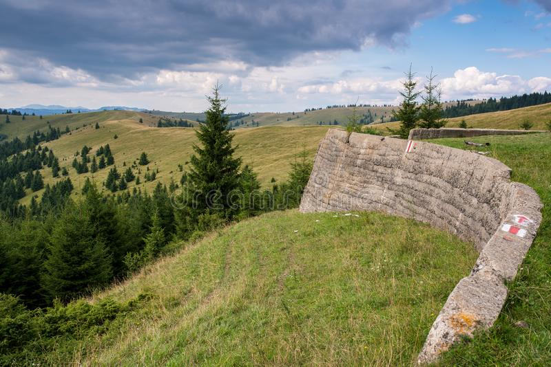 Concrete retaining wall build during World War One by Austro Hungarian Empire on a small forest road royalty free stock image
