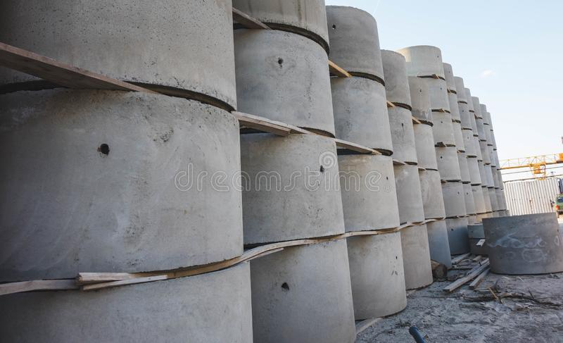 Concrete ring wells with different diameters and gray lie in the street stock images