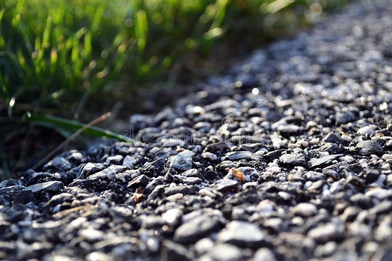 Concrete road next to a meadow stock images
